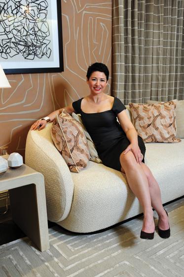 Rachel Dougan relaxes on a divan in the Kravet showroom. © Michael Ventura