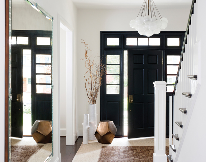 An Apparatus Studio chandelier graces the foyer, where the cherry door, transom and sidelites were stained black.