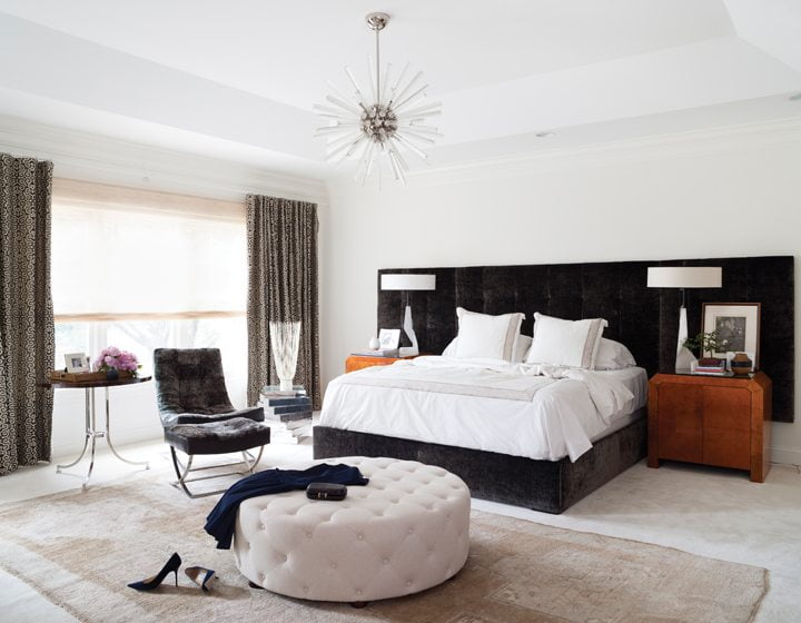 A Hickory Chair bed anchors the master bedroom. The chandelier is by Arteriors.
