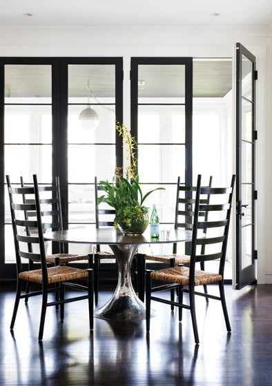 The breakfast room opens to a screened porch.