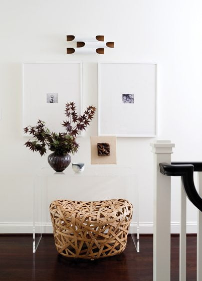 Framed photographs of Meyer's daughters are hung on the upstairs landing.