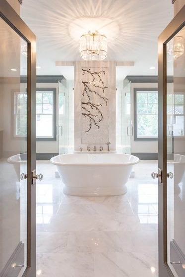 Double glass doors lead from the master bedroom into the tranquil bath.