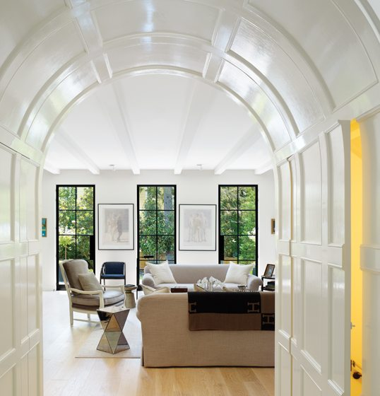 A deep archway connects the entry and living room, where the view is the main attraction.