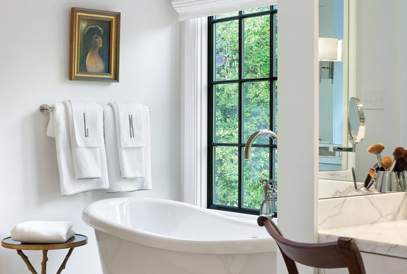 The master bath features a soaking tub from Americh.