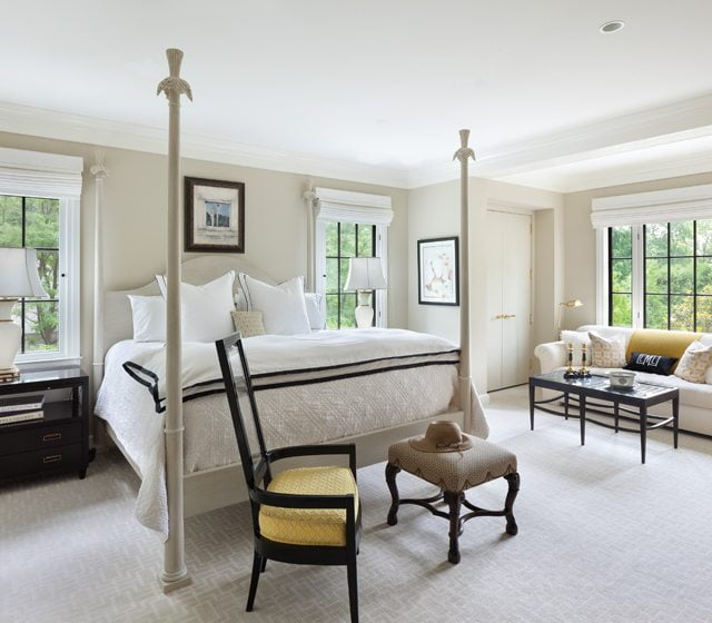 The master bedroom is a restful retreat with a four-poster bed.