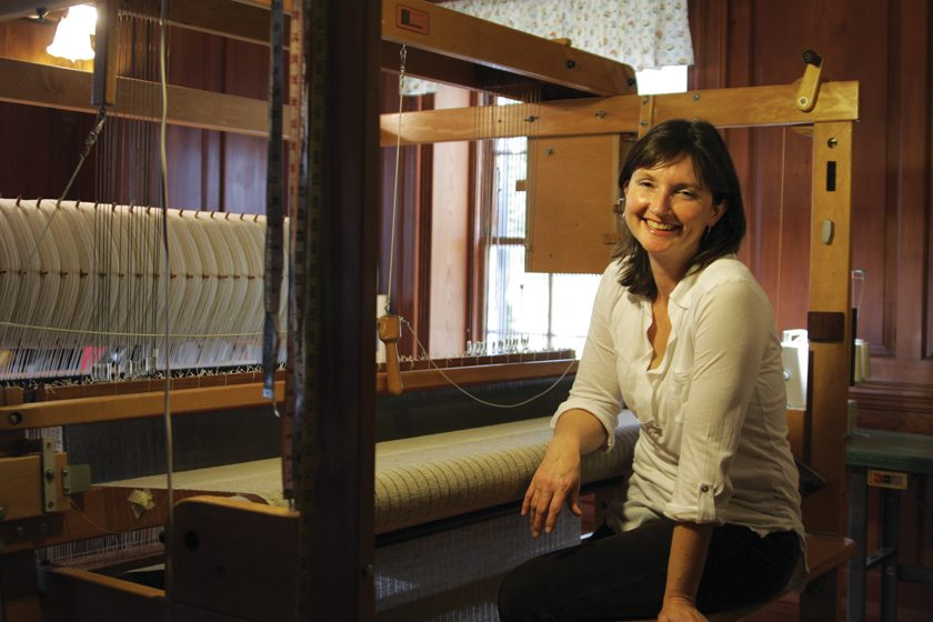 Pictured in her rural Virginia home studio southeast of Richmond, Dianne Nordt works at a massive loom.