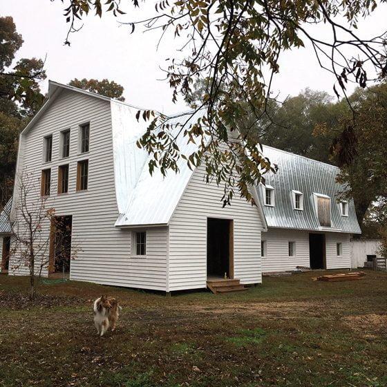 A barn, rebuilt on its original foundation, houses the farm's 40 sheep.