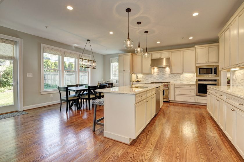 Washington Metropolitan Homes completed a grand kitchen with a large island in a speculative residence.