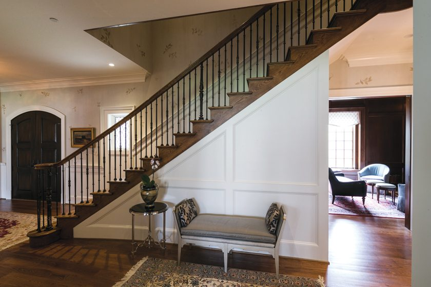 A custom home by Sandy Spring Builders includes an elegant foyer with detailed millwork.