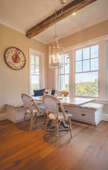 The breakfast area in a traditional home by GTM Architects boasts a built-in banquette.