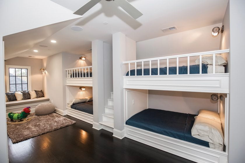 A playroom with built-in bunk beds is a popular children's hangout in a home by Castlewood Consulting, LLC.