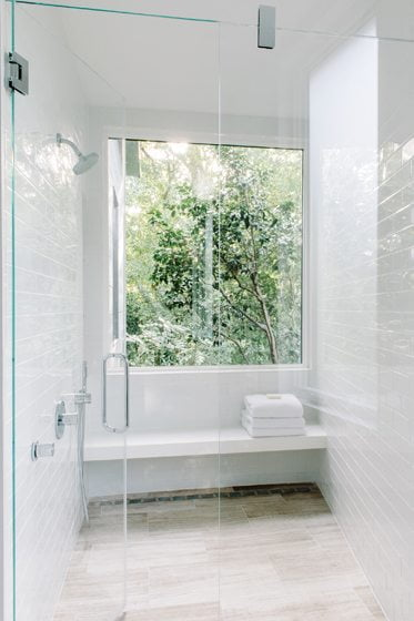 The shower window looks out on the wooded edge of the Chesapeake & Ohio Canal National Park.