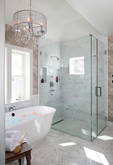 Elegant Carrara marble tile from Architectural Ceramics is applied on the floor and shower walls.