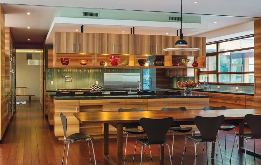 Potomac Woodwork fabricated the table and cabinetry in the kitchen.