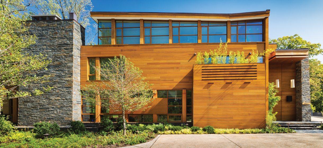 The street-side façade reveals an exterior palette of sapele mahogany, stone and glass.