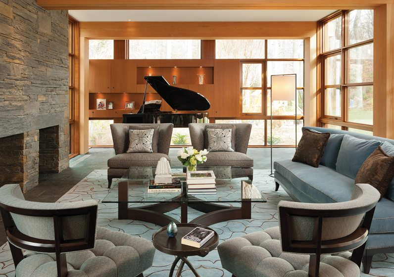 The living area's palette echoes the colors of the stone chimney wall. © Paul Burk