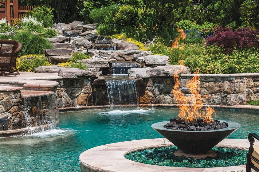 The McHale pool scape integrates stonework and waterfalls.