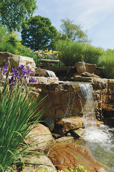 Another waterfall feature by McHale adds drama to a Great Falls landscape. © McHale Landscape Design