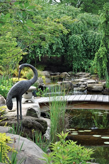 The Zen garden by McHale boasts statuary and a footbridge. © John Spaulding
