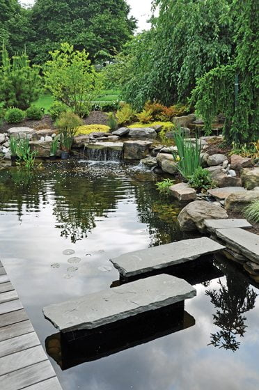 Ryan Davis of McHale added stepping stones across a pond in a Zen garden. © John Spaulding