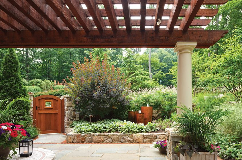 A trio of urns adorns a patio in Clifton, Virginia, by Howard Cohen of Surrounds Inc. © Ron Blunt