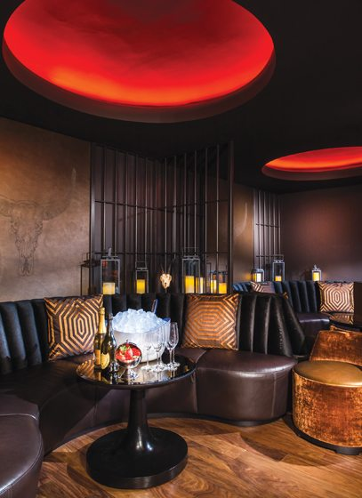 Tufted gold-leather couches and metallic chandeliers at Richard Sandoval's Toro Toro.