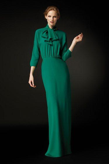CH Carolina Herrera's Emerald green silk evening gown with bow detail.