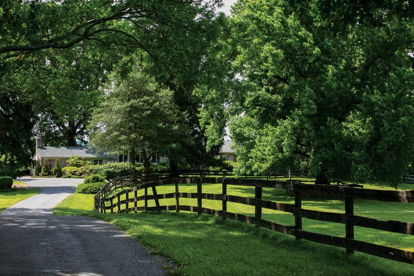 A winding lane meanders through pastures to the home, built in 1948.