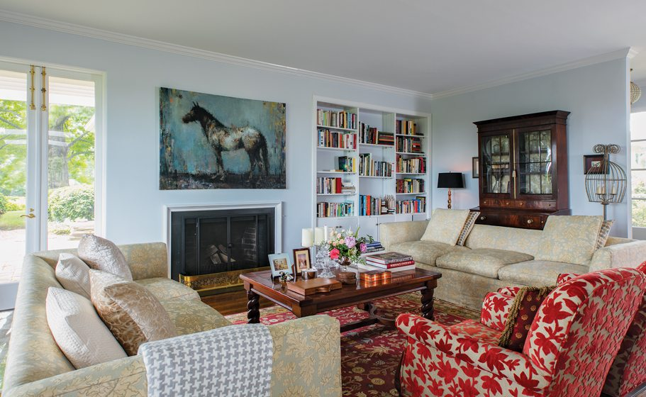 A painting by contemporary artist Jeffrey Terreson hangs in the living room.