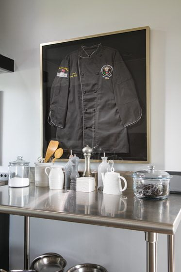 A framed chef's jacket was presented to Wolf after she prepared a luncheon at the White House.