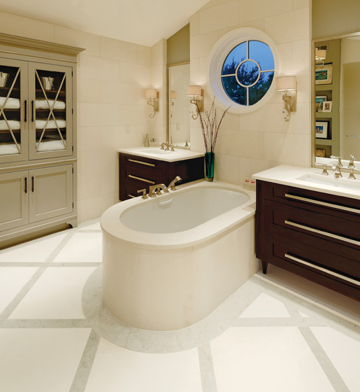 To accentuate the room's cathedral ceiling, Doychinov installed a round window above the new soaking tub.