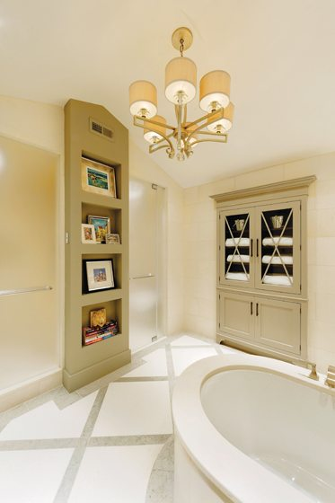 A custom built-in armoire stores toiletries.