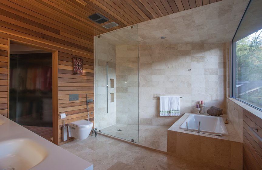 The master bathroom, designed by Price and Julia Walter, is clad in cedar.