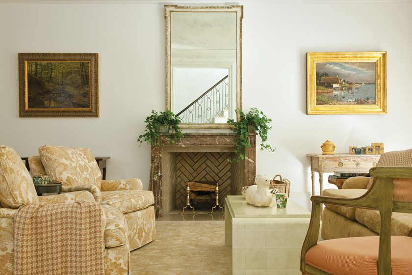 The living room's diminutive antique mantel from Chesney's makes the ceiling seem higher.