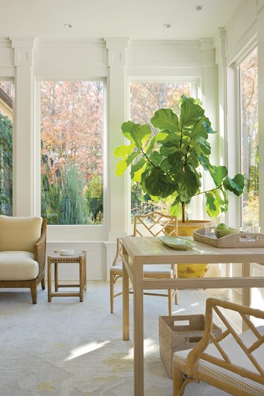 A regular pattern of pilasters around the windows lends dignity to a former sunroom addition.