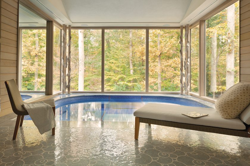A large spa/steam room overlooks the surrounding forest.