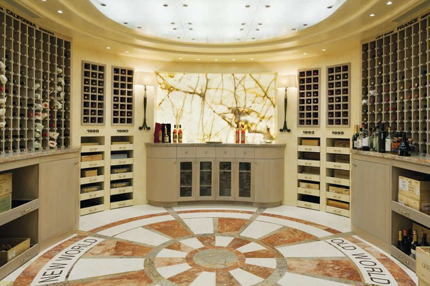 Backlit to emphasize its veining, a wall panel of one-inch-thick alabaster is a focal point in the wine room.