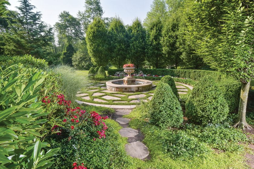 A formal garden, part of a pristine Potomac property, is maintained by Chapel Valley Landscape Company. © Marcus Chacona