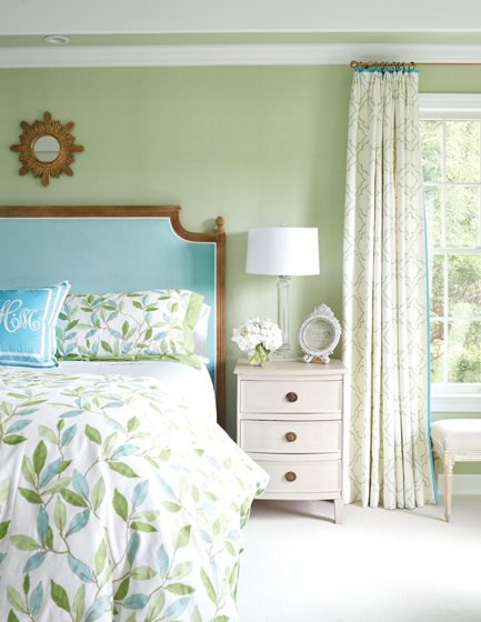 The serene master bedroom boasts a muted palette of blue and green. © Kip Dawkins