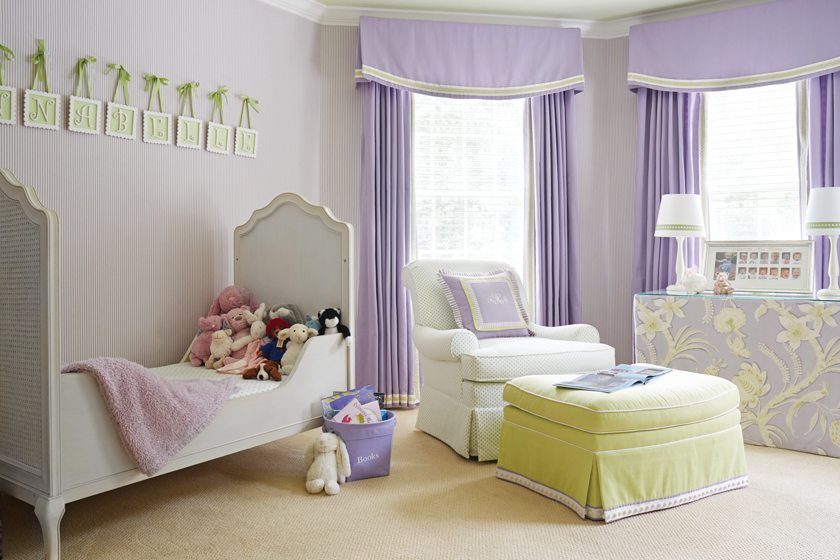 A child-sized bed  is complemented by a lavender color scheme. © Kip Dawkins