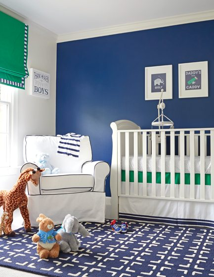 A deep-blue accent wall offsets bright-green window treatments in the boy's room. © Kip Dawkins