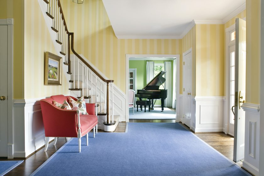 The foyer sets an inviting tone with its bright, primary colors. © Angie Seckinger