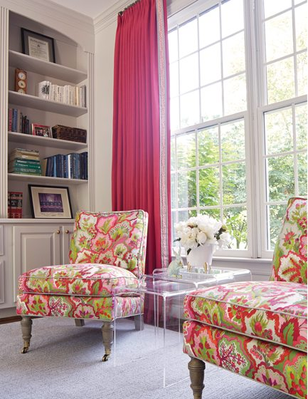 Proxmire updated slipper chairs with vibrant fabric from Manuel Canovas. © Kip Dawkins