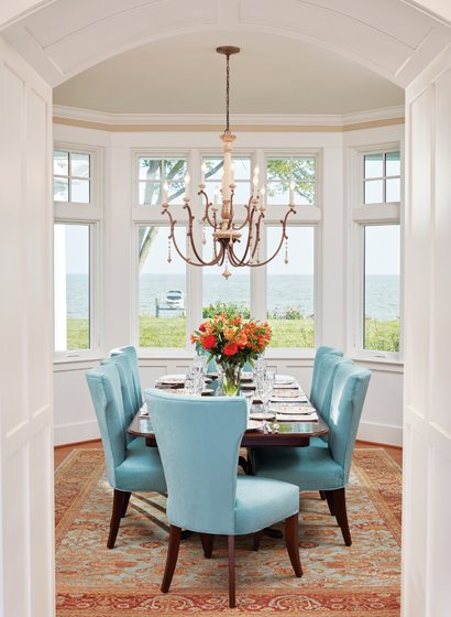 The dining room nestles into a bay window with a sweeping view.