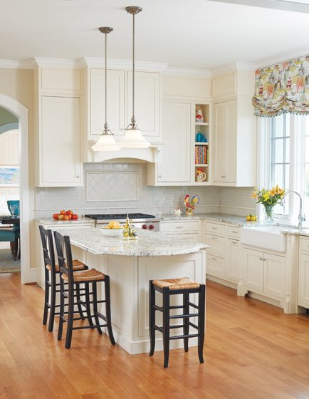 The kitchen features granite countertops and an Atlas Tile backsplash.