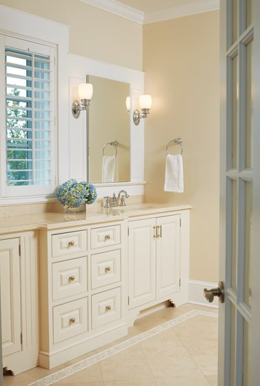 A window provides water views from the master bath's dual vanity.