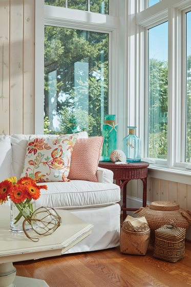 A Lee Industries sofa in the sunroom makes a cozy spot for reading.