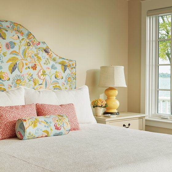 The master bedroom headboard was upholstered by Design Logistics.