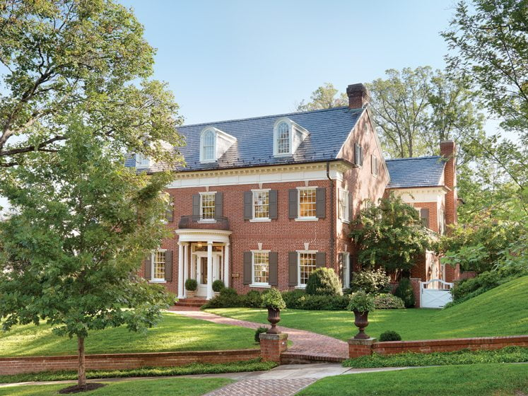 The Colonial Revival home underwent a renovation that involved digging out the landscape to the side of the house.