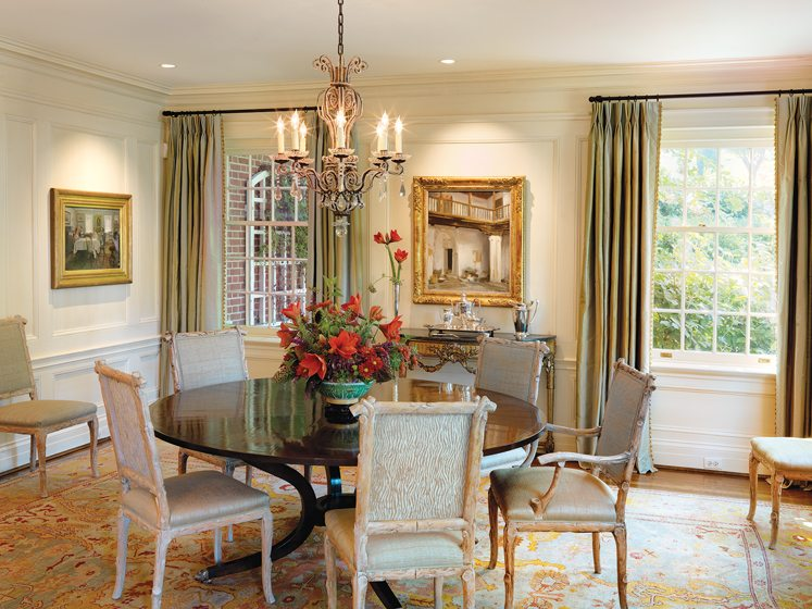 The former dining room was updated with crisp millwork, a Dessin Fournir table and antique chairs.